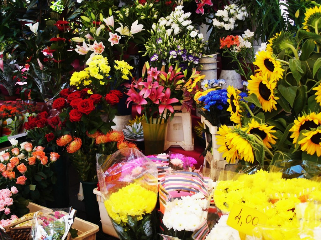 shopping in turin - flower stand at outdoor flower market in turin