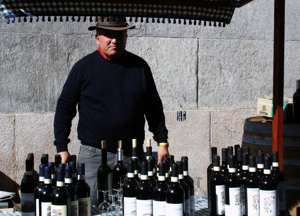 Artisans and Markets in turin - wine producer selling wines at outdoor food market in turin