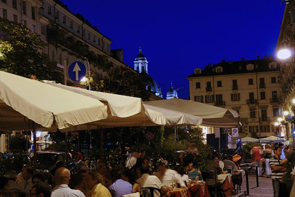 nightlife in turin - the Quadrilatero Romano with people having drinks outside in the piazza