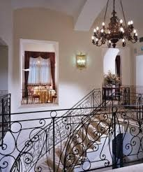 hotels in turin - Best Western Hotel Genio interior with beautiful staircase and chandelier