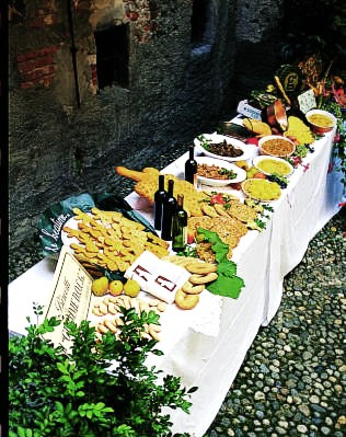 what to eat in turin - a table spread with local food and wine