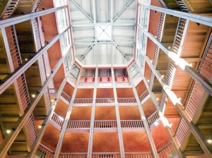 hotels in turin - NH Santo Stefano lobby showing view looking upward of different floors