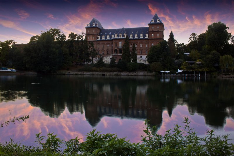 things to do in turin - view of Parco Valentino by night with Po river in front