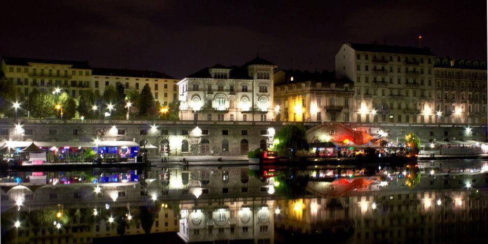 Turin's Po River by night with palaces in background