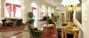 four star hotels in turin - Grand Sitea interior lounge area with traditional furniture and marble floors