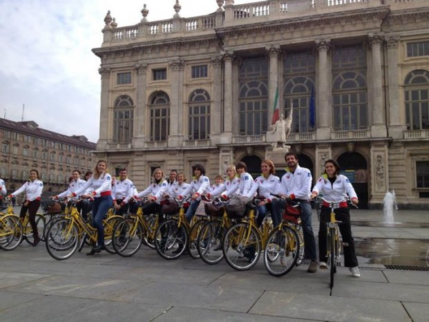 Fitness in Turin - group of people using Turin's city bikes in front of Palazzo Madama