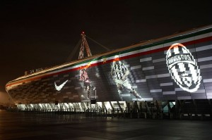 Turin football - the Juventus stadium lit up at night with Juventus logo