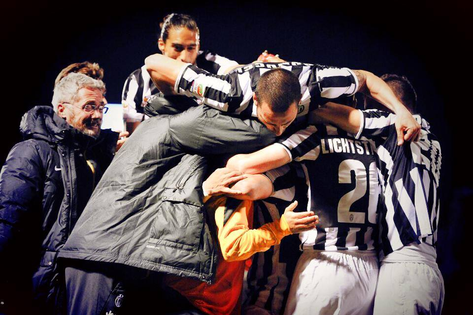 Turin Football - Juventus team players celebrating a win hugging each other