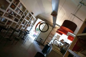 Cafes & Bars in Turin - Mood cafe interior with bookshelves and bar with modern interion