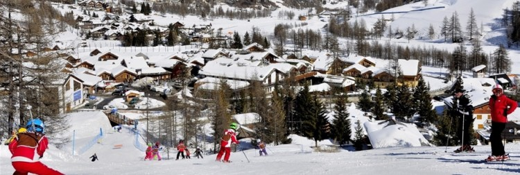 Places for skiing in Piedmont include Pragelato featured in with skiers and Pragelato village in the background