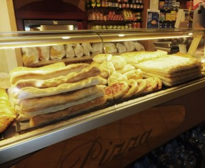 bread in italy - Italian Bakery with Pizza displayed in window