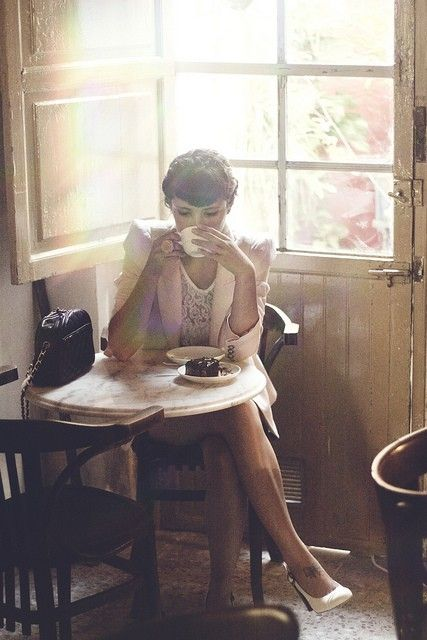lady drinking coffee in cafe