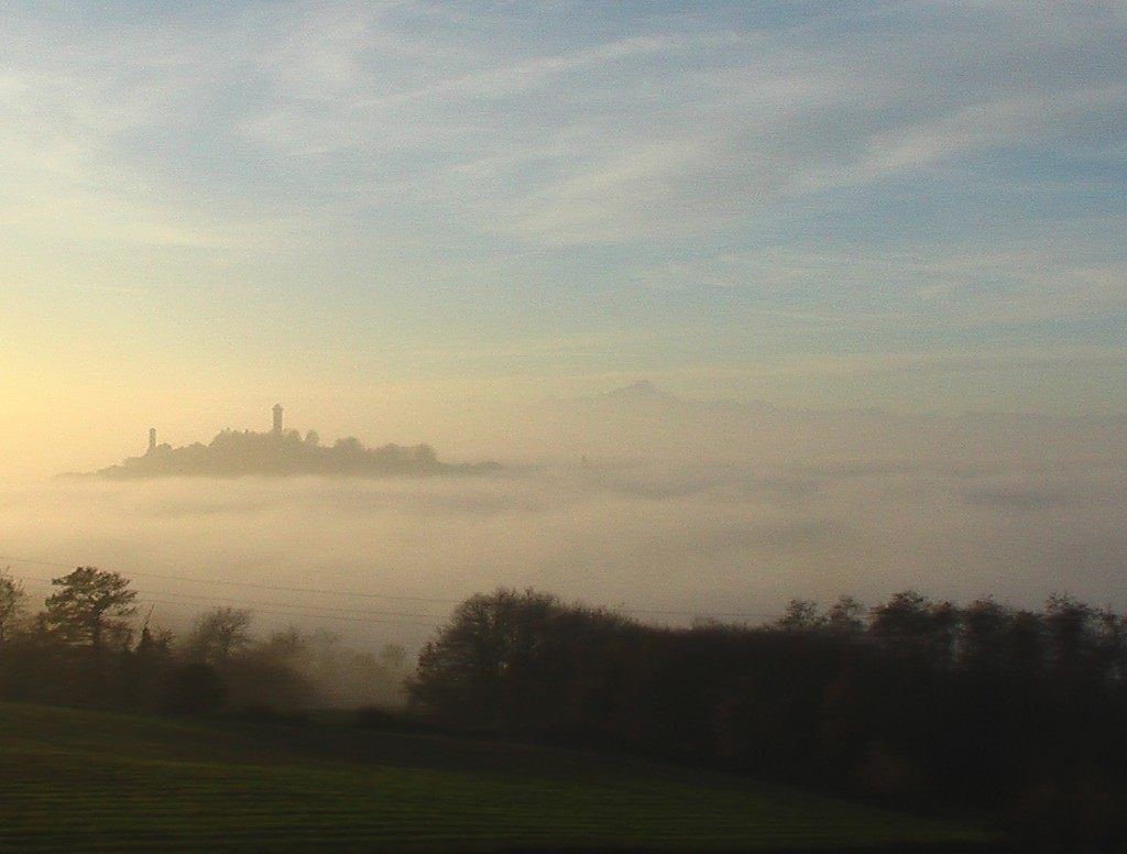 Murazzano rising from the mist - a place in the alta langa