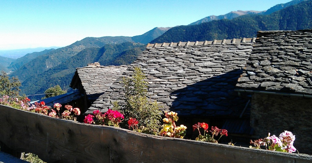 Valle Maira - Dronero in Piedmont. A mountain village with slate roof tops