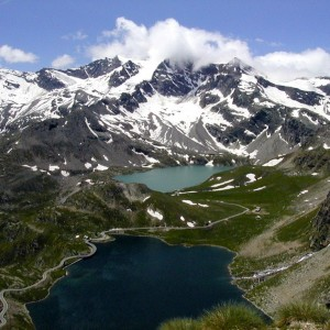 Gran Paradiso National Park snowcapped mountains with alpine lake in the valley