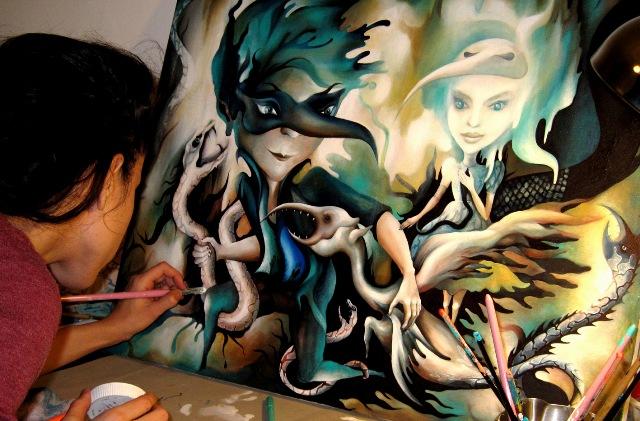 Valentina paiting in her art studio