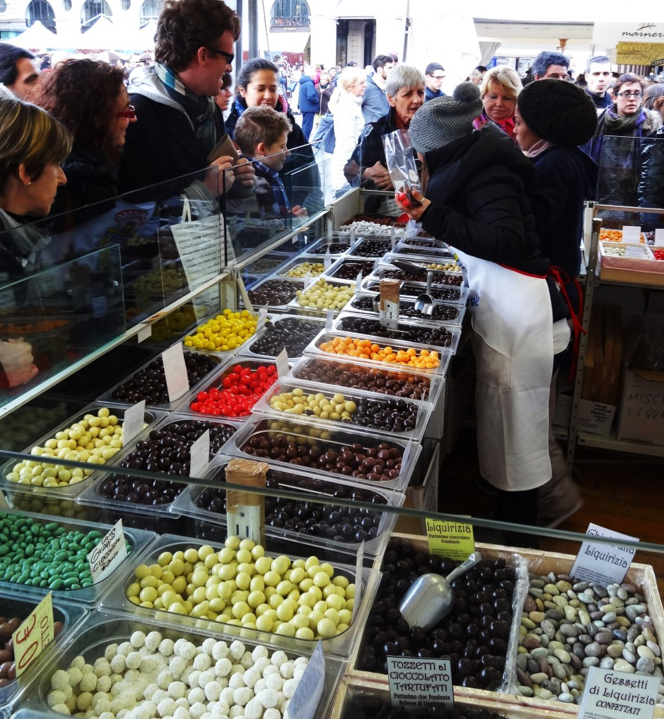 chocolate vendors selling different types of chocolates to customers during Turin Chocolate Festival