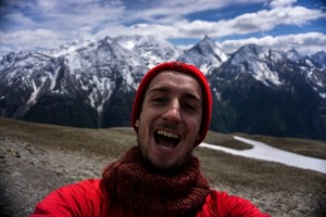 Trekking Alps owner and writer of this post, Roberto Calcagno standing in front of mountains hiking