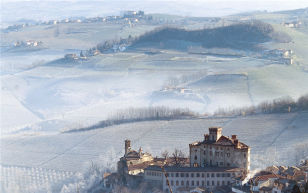 Barolo castle with rolling hills in the midst