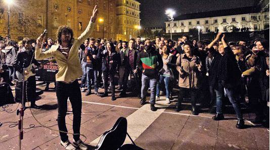 musicians in turin include Buskers Street Band lead singer playing in the streets