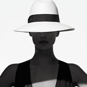 Lady in black and white wearing a white Borsalino hat