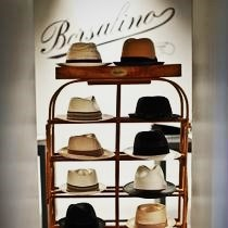 Borsalino hats of different styles and colors on a shelf