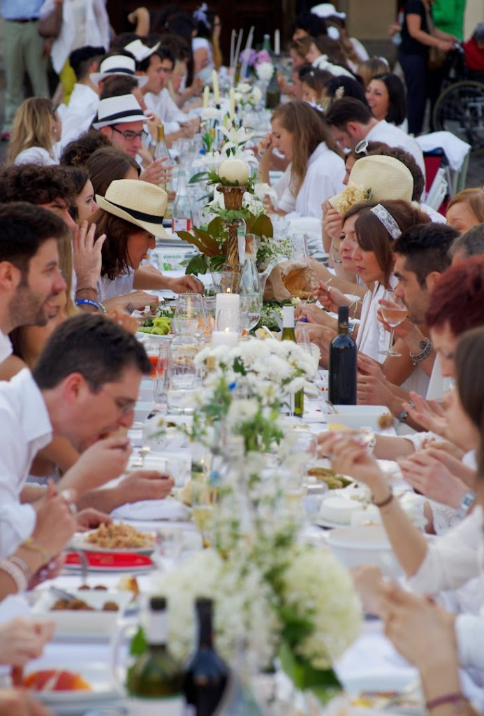 Cena in Bianco people eating at a long white table