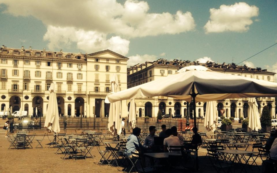 Cafes & bars in Turin - La Drogheria Bar view of piazza with people sitting drinking al fresco
