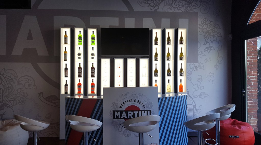 Casa Martini bar with seats and bottles on shelves