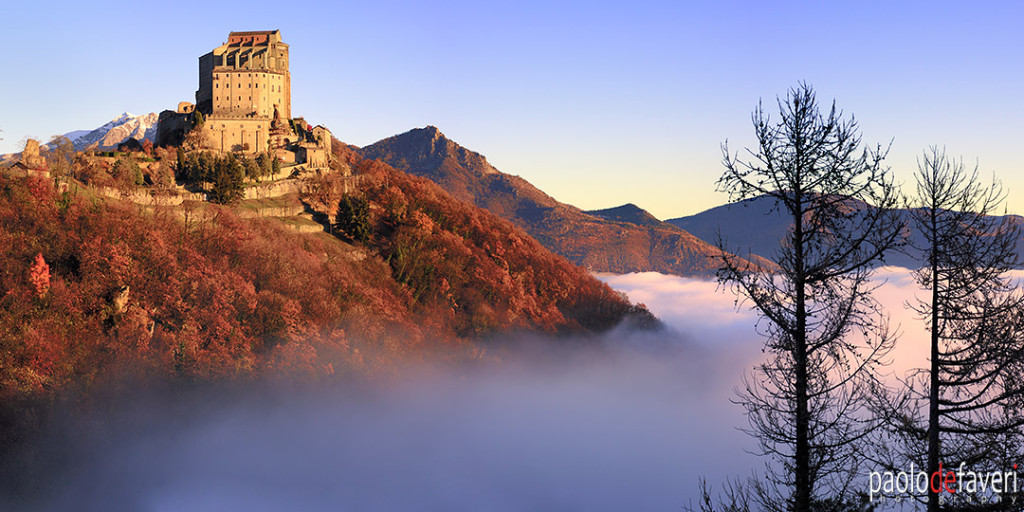 things to see in piedmont - the abbey known as Sacra di San Michele emerging above an amazing sea of fog. Taken a few moments after sunrise at the end of November.