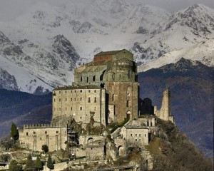 Sacra di San Michele with snow capped mountains in the distance