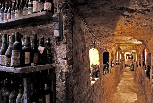 Monferrato's Infernot, a wine cave with stone shelves of wine bottles