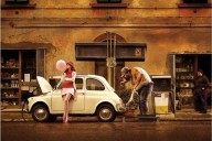 Vintage Fiat 500 with lady putting gas in car at vintage gas station