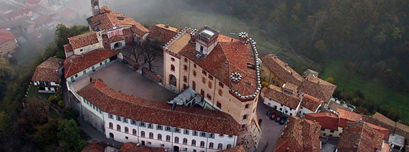 Aerial photo of the town of Barolo and its castle which is along piedmont's wine roads