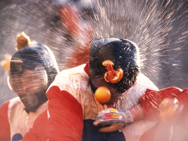 One of the team members getting hit with oranges during the battle of oranges