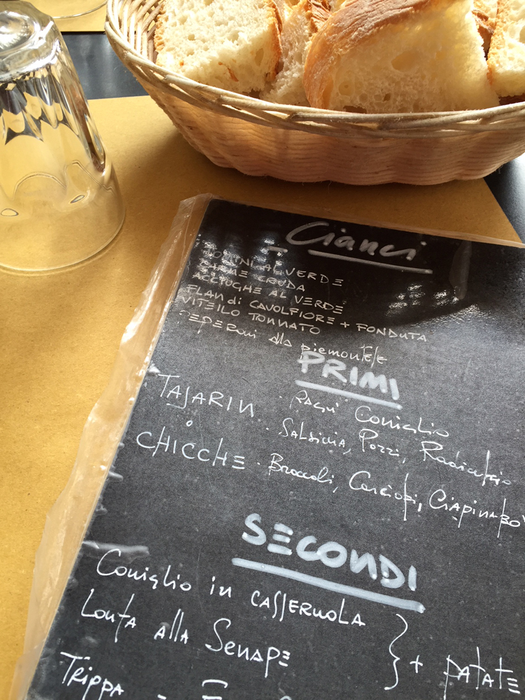 Da Cianci's menu on table with a basket of bread