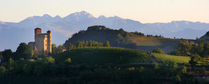Piedmont's wine roads - Serralunga d'Alba castle with vineyards and mountains in the background