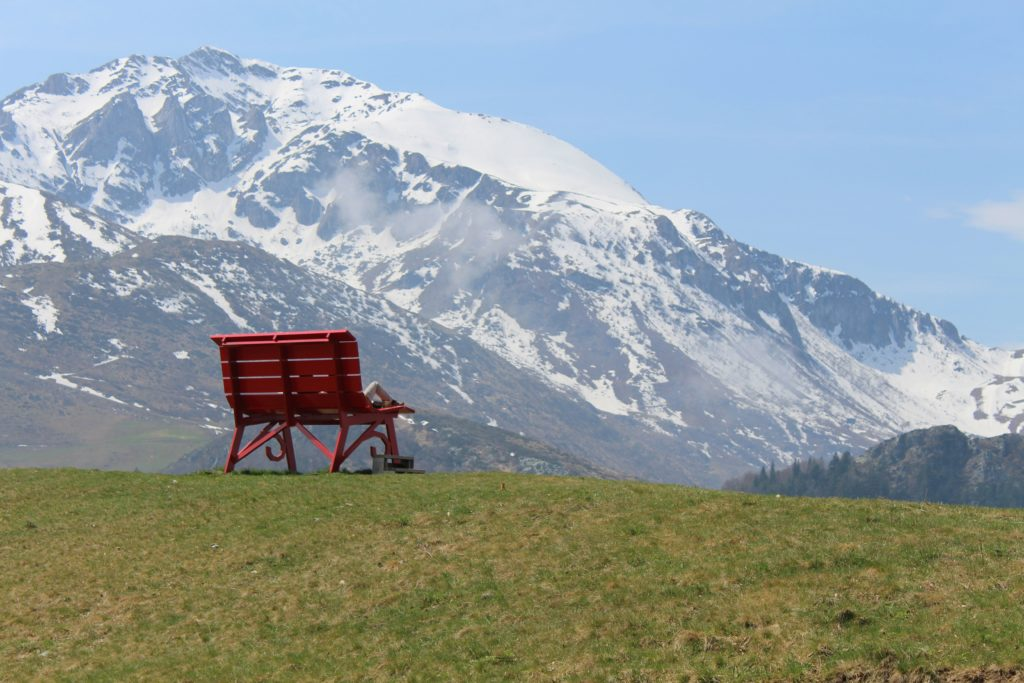 Big benches in piedmont includes this Big Bench in the Piedmont mountains featured in red with person lounging on big bench admiring the views