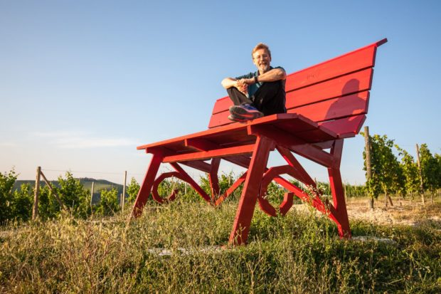 Chris Bangle on original red Big Bench in Piedmont